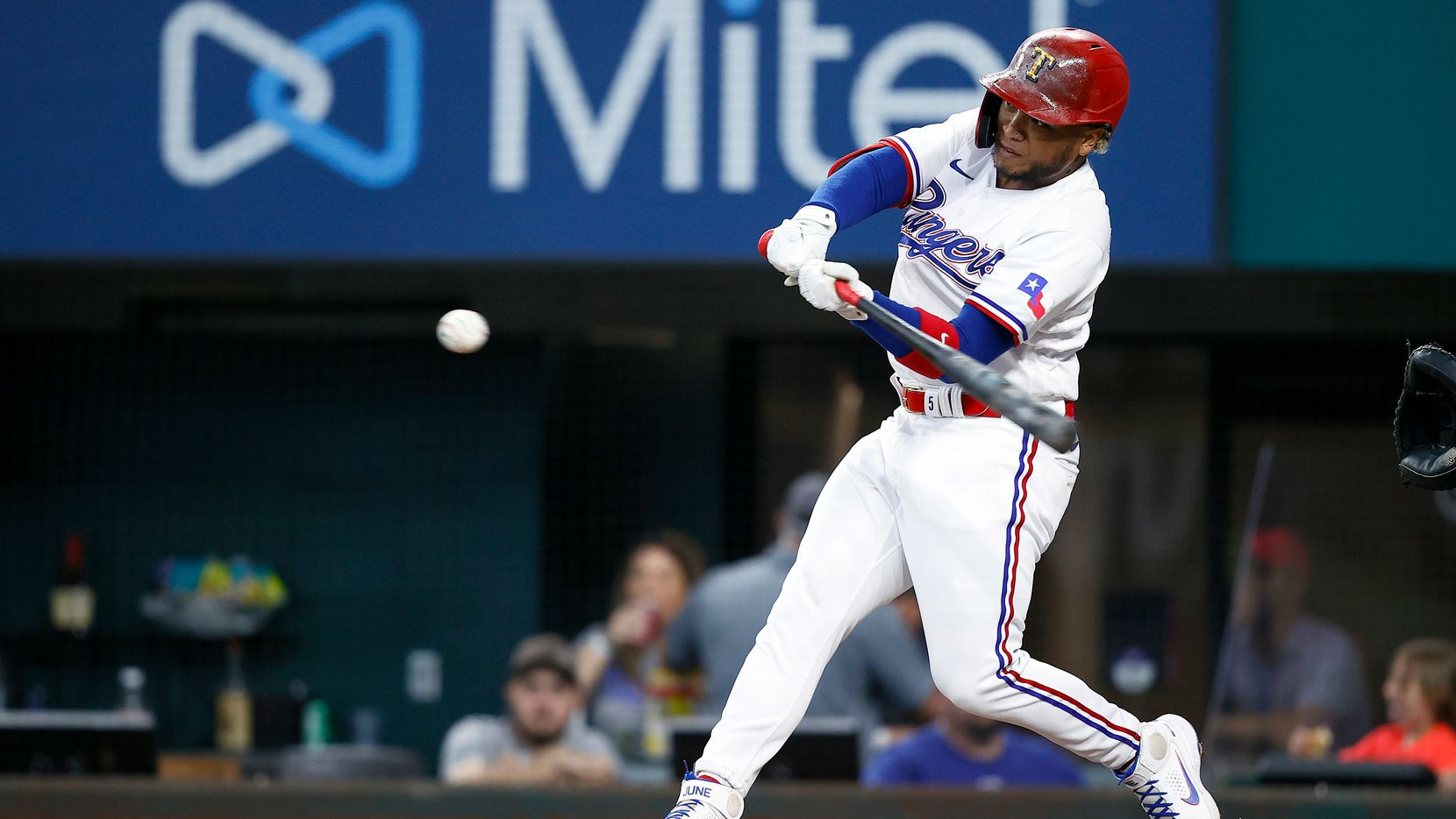 Willie Calhoun #5 of the Texas Rangers hits a double against the New York Yankees in the bottom of the third inning at Globe Life Field on May 20, 2021 in Arlington, Texas.