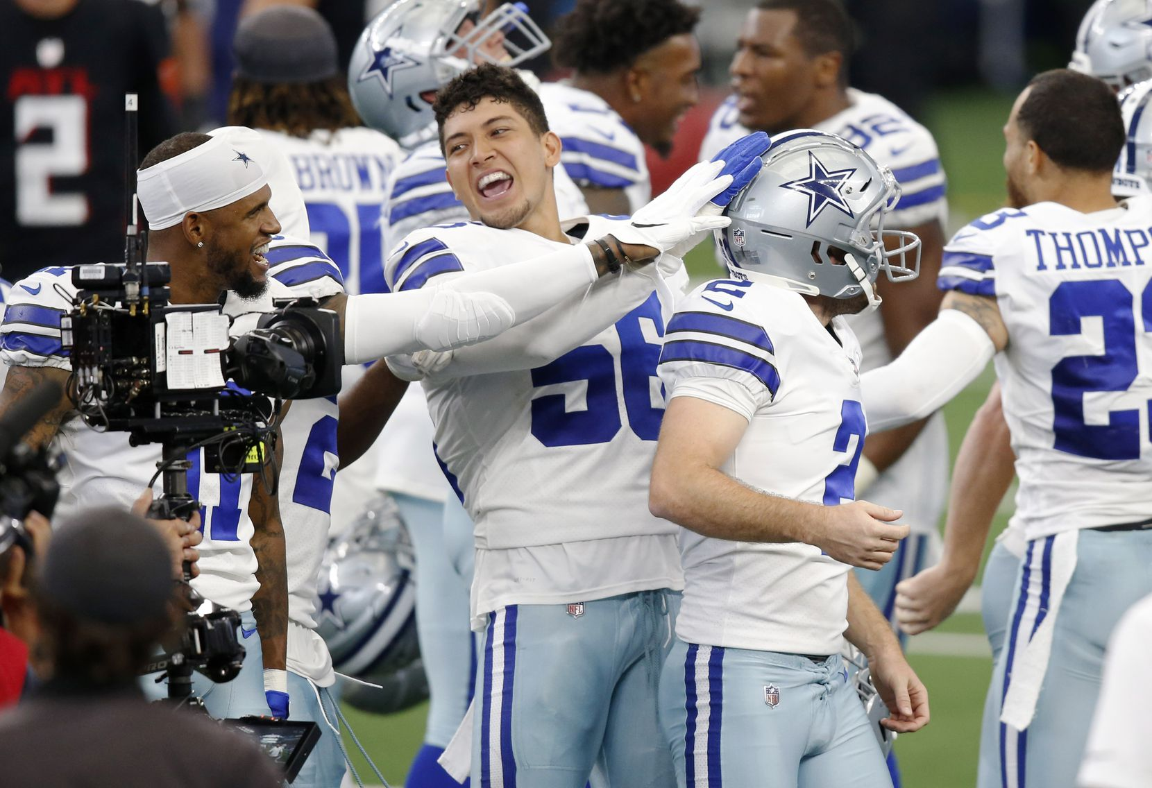 Cowboys wide receiver Malik Turner (17) and defensive end Bradlee Anae (56) congratulate kicker Greg Zuerlein (2) after he hit a game-winning field goal against the Falcons at AT&T Stadium in Arlington on Sunday, Sept. 20, 2020.