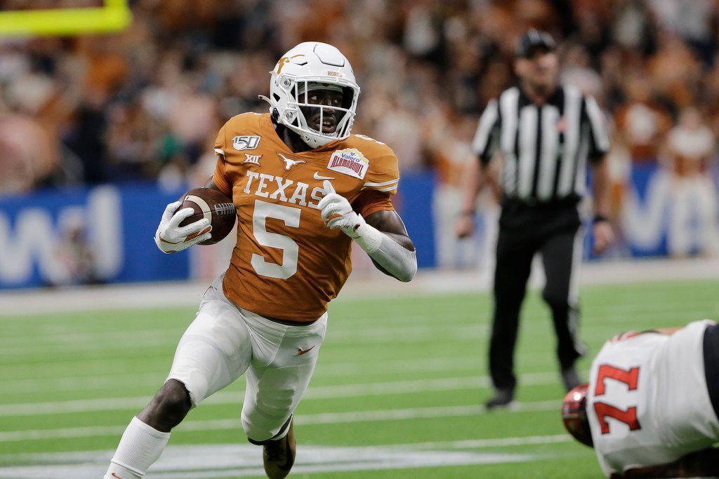 Texas' D'Shawn Jamison (5) returns a punt during the first half of the Longhorns' 38-10 win over the Utes in the Alamo Bowl in San Antonio, Tuesday, Dec. 31, 2019. (AP Photo/Austin Gay)