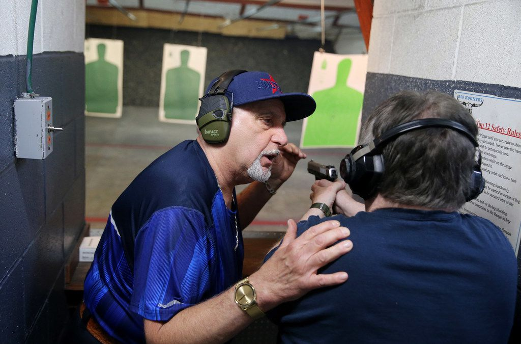 Instructor Mark Giordonello (left) talks to Robert Graham, of Friendswood, TX, during a license to carry class hosted by Giordonello at Big Kountry Shooting and Archery gun range in Alvin, TX Saturday May 19, 2018. On Friday morning, 10 people were killed and 13 were injured after a shooting at Santa Fe High School. Dimitrios Pagourtzis was booked into the Galveston County Jail on capital murder charges. The class was scheduled before the shooting occurred. (Andy Jacobsohn/The Dallas Morning News)