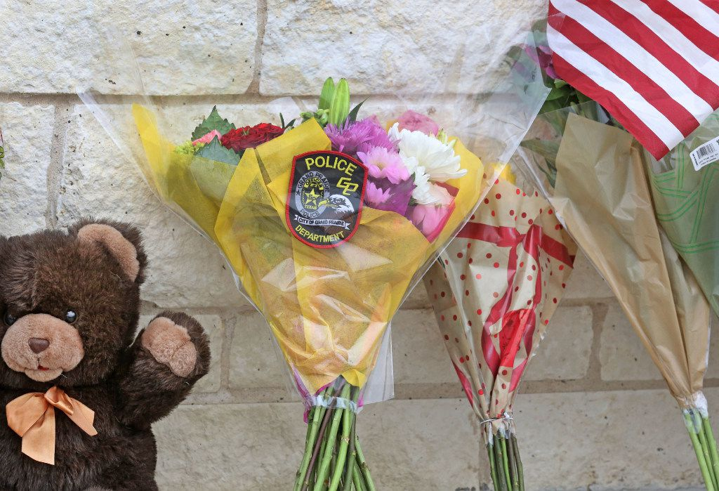 Flowers are placed outside the Little Elm Police Department for Detective Jerry Walker. (Louis DeLuca/Staff Photographer)