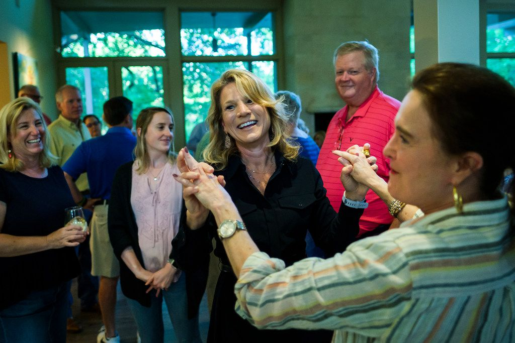Dallas City Council member Jennifer Staubach Gates celebrates with supporters after early voting results showing her with a lead on challenger Laura Miller were posted during an election night watch party on Saturday, May 4, 2019, in Dallas.