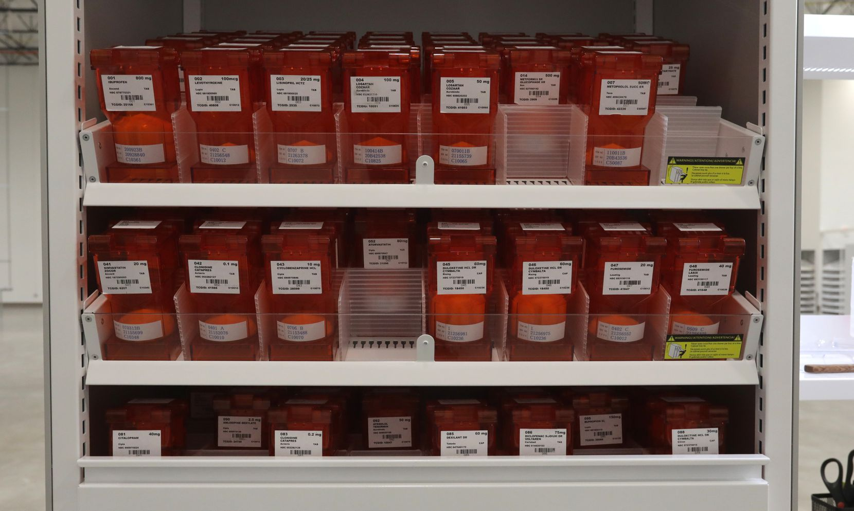 Medication bulk canisters used for fulfilling orders with NavixRx.