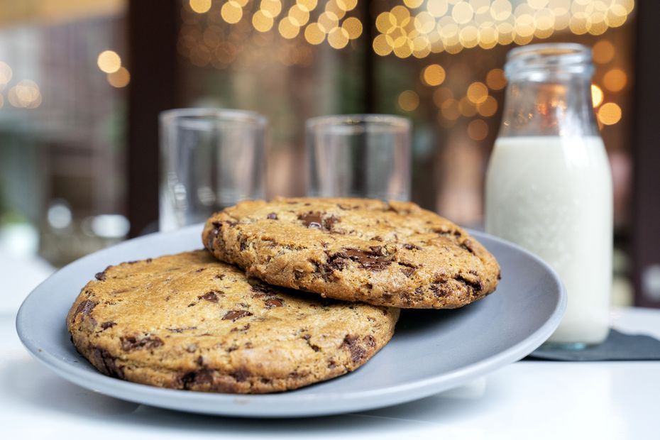 Chocolate chip cookies are served with oat milk at Belse Plant Cuisine.