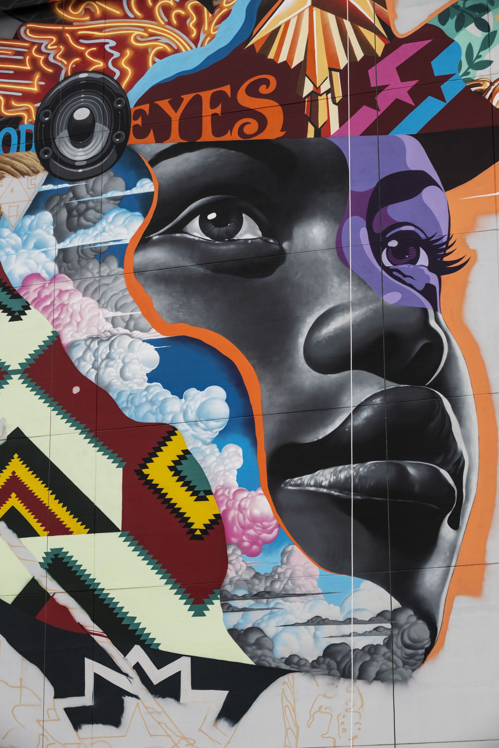 An image of a Black woman is part of a new mural being painted on The Stack building in Deep Ellum by artist Tristan Eaton, on Thursday, March, 11, 2021. The mural is covering 8,500 square feet with iconic images such as legendary local guitarist Stevie Ray Vaughan, Blues musician Lead Belly, Texas' first practicing Black architect William Sidney Pittman and fashion icon Jerry Hall.