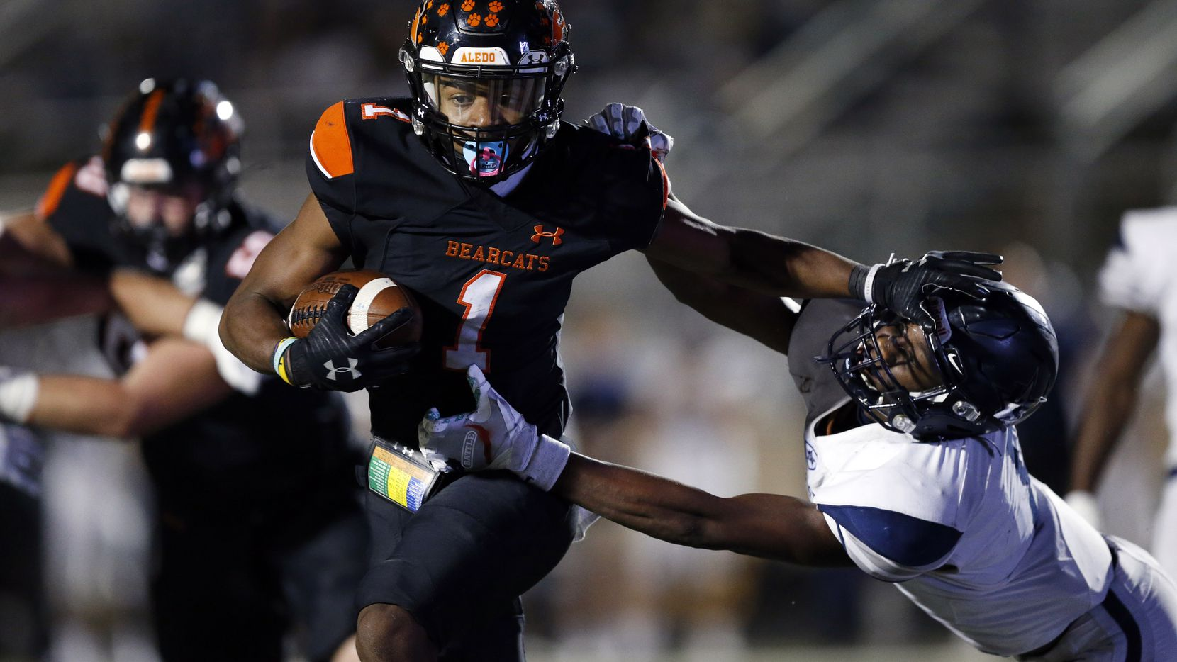 Aledo receiver JoJo Earle (1) gives a stiff-arm to Frisco Lone Star's Devin Turner during a game on October 2 2020. Aledo won 34-32. (Tom Fox/The Dallas Morning News)