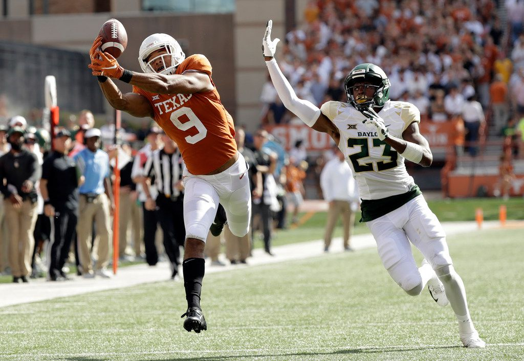 Texas wide receiver Collin Johnson (9) makes a catch in front of Baylor cornerback Derrek Thomas (23) for 44-yard touchdown reception during the first half on an NCAA college football game, Saturday, Oct. 13, 2018, in Austin, Texas. (AP Photo/Eric Gay)