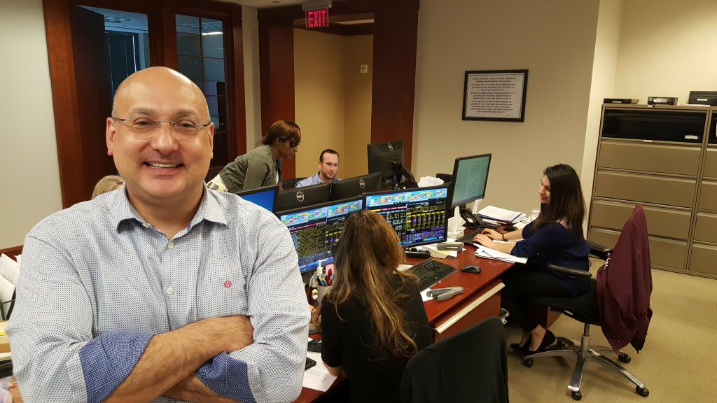 Gilbert Garcia, managing partner of Garcia Hamilton & Associates LP, in the Houston investment firm's trading room.