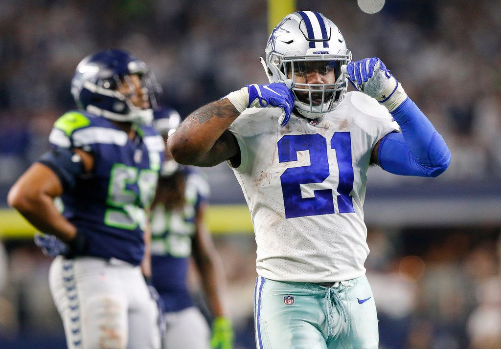 Dallas Cowboys running back Ezekiel Elliott (21) gives the 'double spooning' motion after a big fourth run against the Seattle Seahawks in the NFC Wild Card game at AT&T Stadium in Arlington, Texas, Saturday, January 5, 2019. The Cowboys won, 24-22. (Tom Fox/The Dallas Morning News)