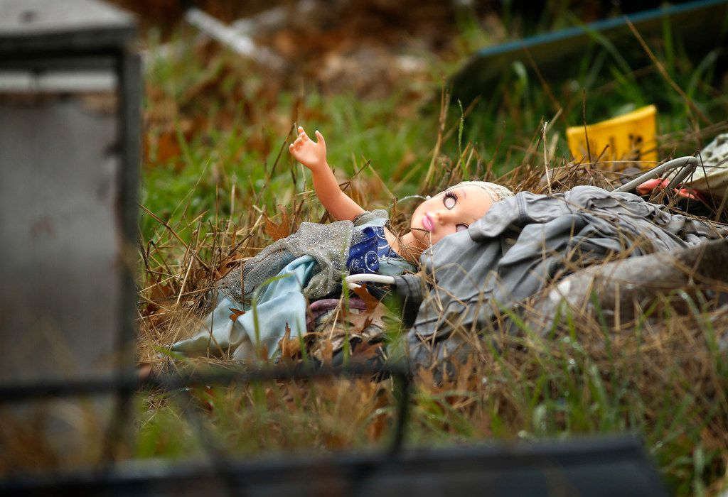 """A child's doll is seen among the debris in the front yard of a wrecked home in the 3500 block of Espanola Drive on Tuesday. Linda """"Michellita"""" Rogers, 12, died in the explosion. This Saturday will mark one year since Michellita died."""