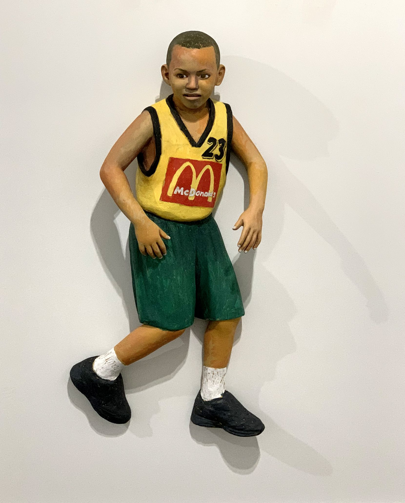 """John Ahearn's 2005 work """"Jhovan"""" features a young basketball player."""