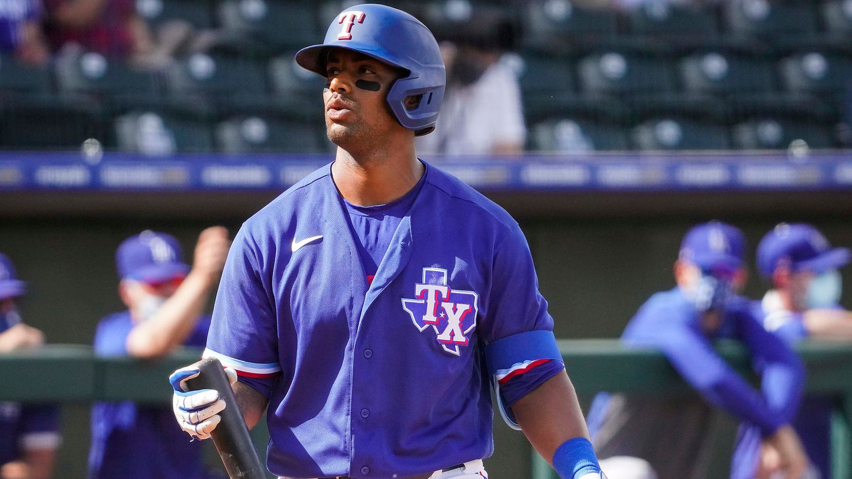 Texas Rangers designated hitter Khris Davis heads back to the dugout after striking out during the sixth inning of a spring training game against the Los Angeles Dodgers at Surprise Stadium on Sunday, March 7, 2021, in Surprise, Ariz. (Smiley N. Pool/The Dallas Morning News)