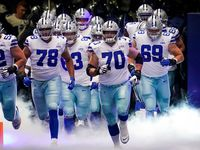 Dallas Cowboys offensive guard Zack Martin (70) leads the team onto the field to face the New York Giants in an NFL football game at AT&T Stadium on Sunday, Oct. 11, 2020, in Arlington. (Smiley N. Pool/The Dallas Morning News)