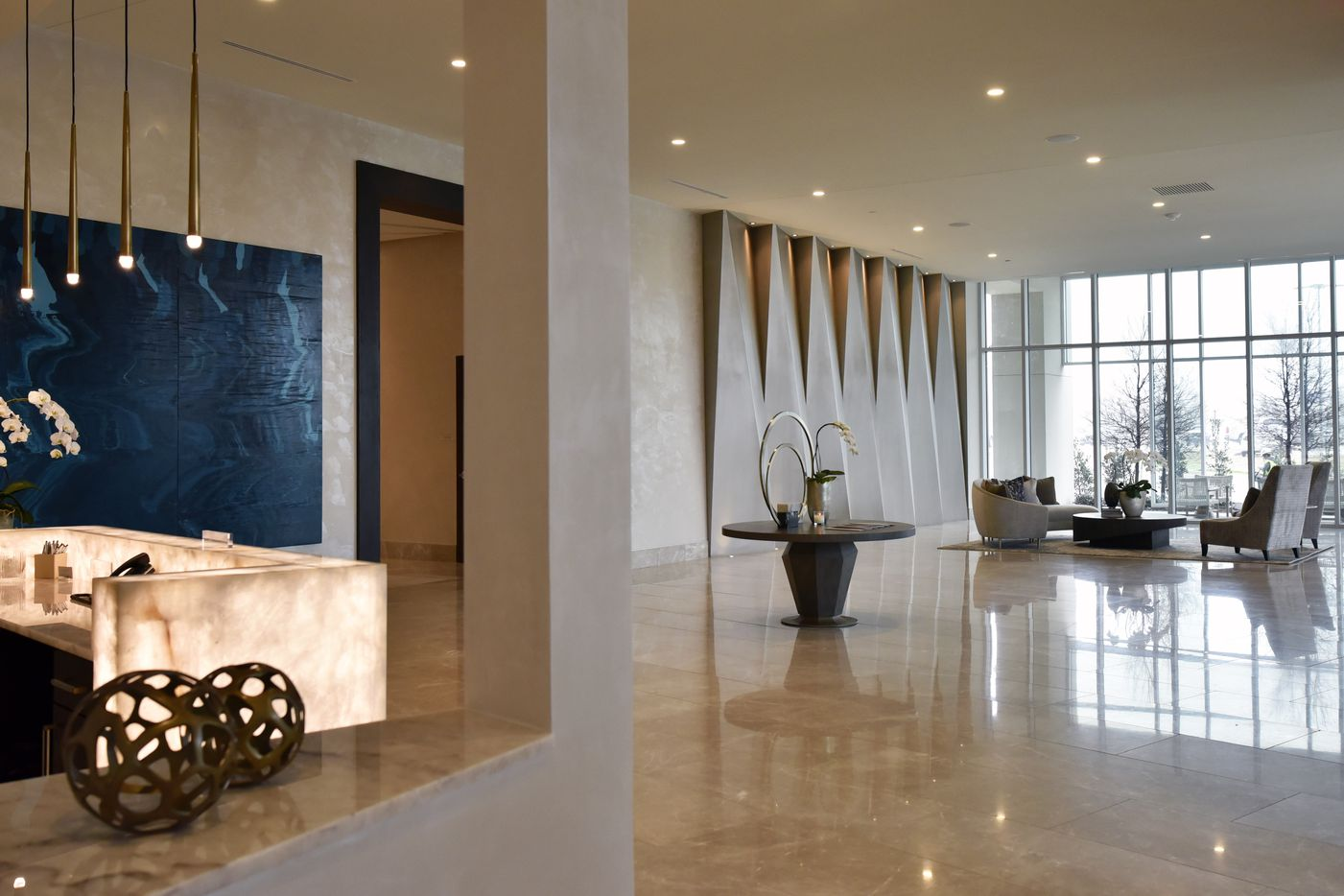 The lobby area and front desk inside the Twelve Cowboys Way luxury residential tower at the Star in Frisco.