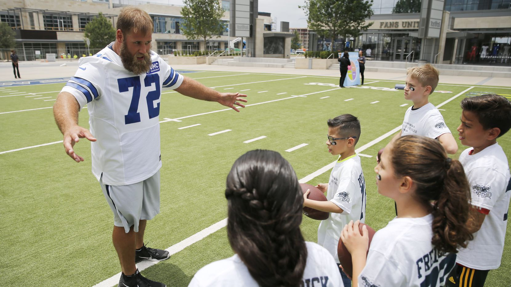 Dallas Cowboys center Travis Frederick (72) explains the next exercise to fourth graders from Christie elementary school during a Frisco ISD's Fuel Up to Play 60 program in front of the Ford Center at The Star in Frisco on Tuesday, May 16, 2017.