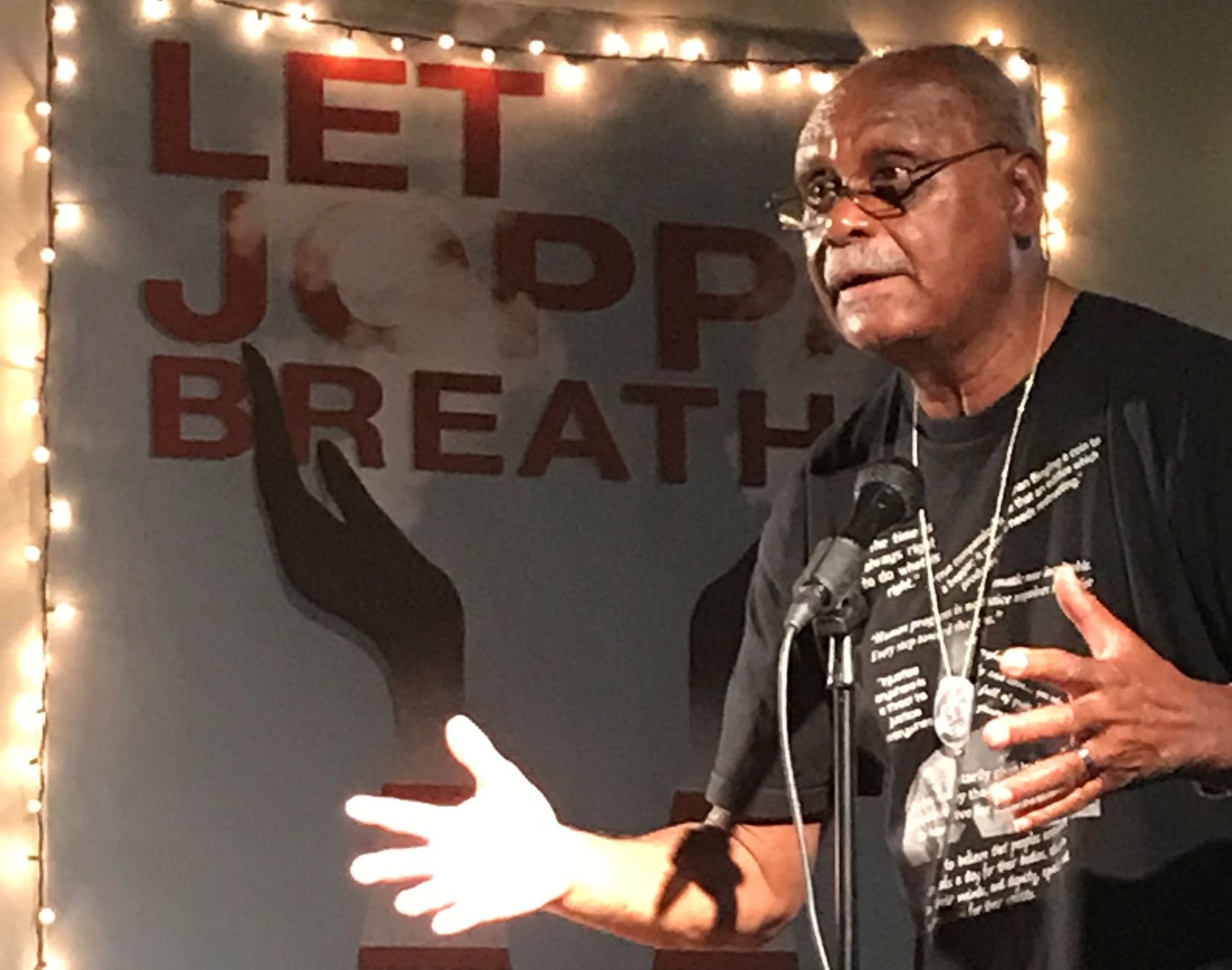 The Rev. Peter Johnson implores residents to support Joppa two years ago during a fundraiser for one of Dallas' oldest African-American neighborhoods.