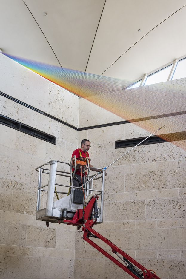 Artist Gabriel Dawe installing Plexus 34 at the Amon Carter Museum of American Art
