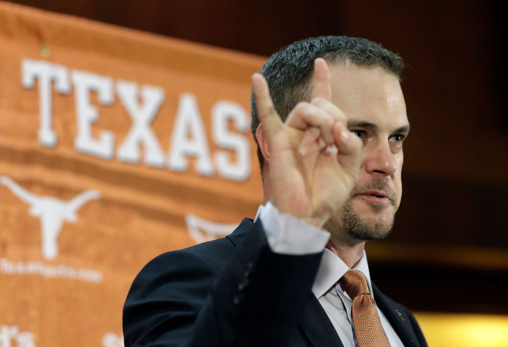 Tom Herman holds up the Hook 'em Horns sign during a news conference where he was introduced as Texas' new head NCAA college football coach, Sunday, Nov. 27, 2016, in Austin. (AP Photo/Eric Gay) ORG XMIT: TXEG105
