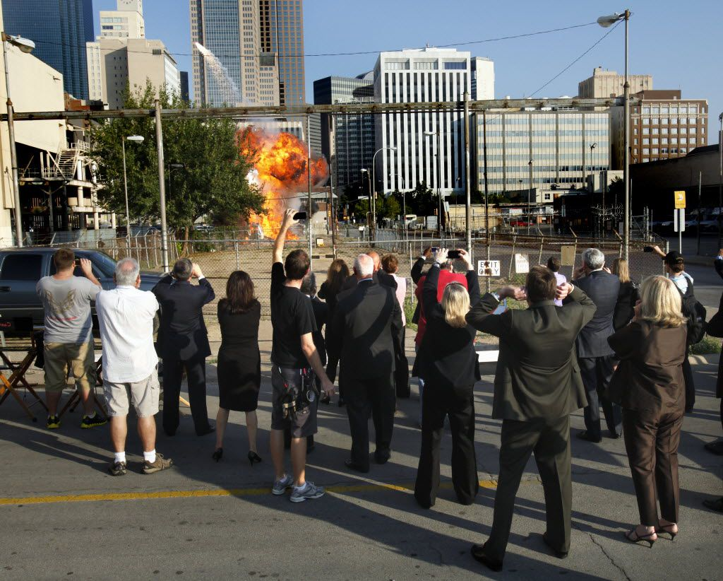 Members of the Dallas City Council and crew members from the television series The Good Guys stood at a safe distance October 20, 2010 as an Airstream trailer was blown up at the intersection of St. Paul and Young Streets in Dallas. (Jim Mahoney/The Dallas Morning News