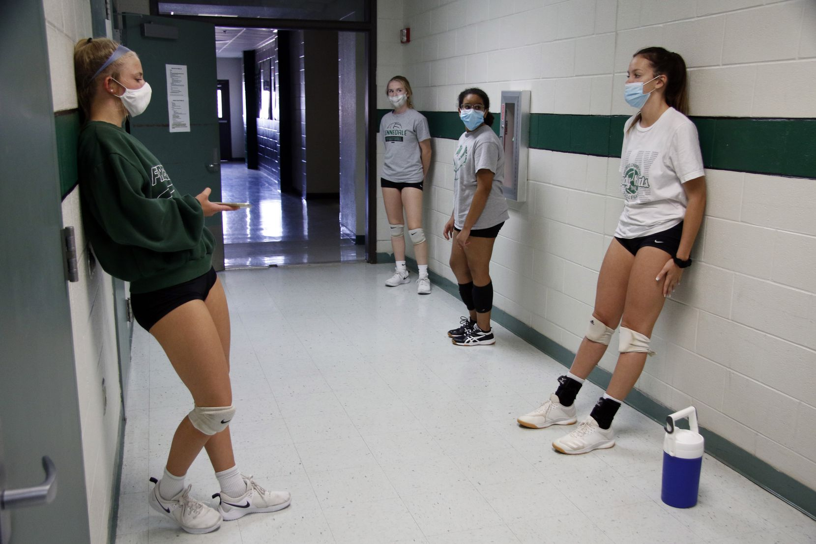 Kennedale volleyball players wait for practice to start Monday. (Steve Hamm/ Special Contributor)