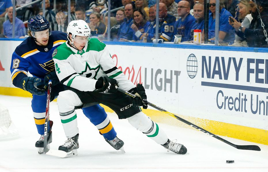 FILE - Stars defenseman Miro Heiskanen (4) controls the puck from Blues center Robert Thomas (18) during the second period of a game at Enterprise Center in St. Louis on Tuesday, May 7, 2019. The teams were playing Game 7 of a second-round Western Conference playoff series.