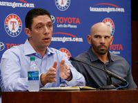 FILE — Texas Rangers general manager Jon Daniels and manager Chris Woodward talk to the media during the Texas Rangers end of season news conference, in Arlington, Tx, on October 1, 2019.