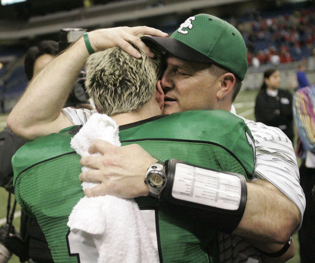 Southlake Carroll head coach Todd Dodge steals a moment with his son QB Riley Dodge (11) after beating Austin Westlake 43-29 for the UIL Division I 5A football state championship at the Alamodome in San Antonio, Texas Saturday December 23, 2006.
