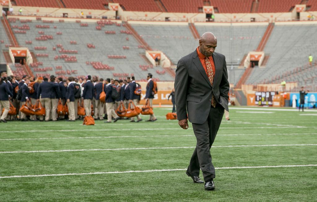 """In this Friday, Nov. 25, 2016 photo, Texas coach Charlie Strong walks across the field at Royal-Memorial Stadium before an NCAA college football game against TCU in Austin, Texas. Texas has """"let go"""" football coach Charlie Strong on Saturday, Nov. 26, 2016, after a 16-21 record in three seasons. Strong had two years left on a guaranteed contract that pays more than $5 million per year (Jay Janner /Austin American-Statesman via AP)"""