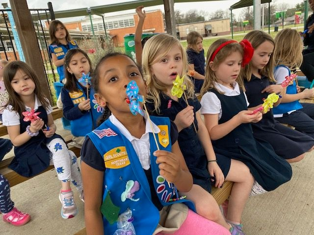 "Members of two Dallas Girl Scouts troops, based out of Kramer Elementary, practice different breath work activities -- blowing bubbles, pinwheels, etc. to put in their ""tool box."" Thls was part of their Okay to Say patch work, and the photo was taken this year, prior to the pandemic closing down in-person Scout meetings."