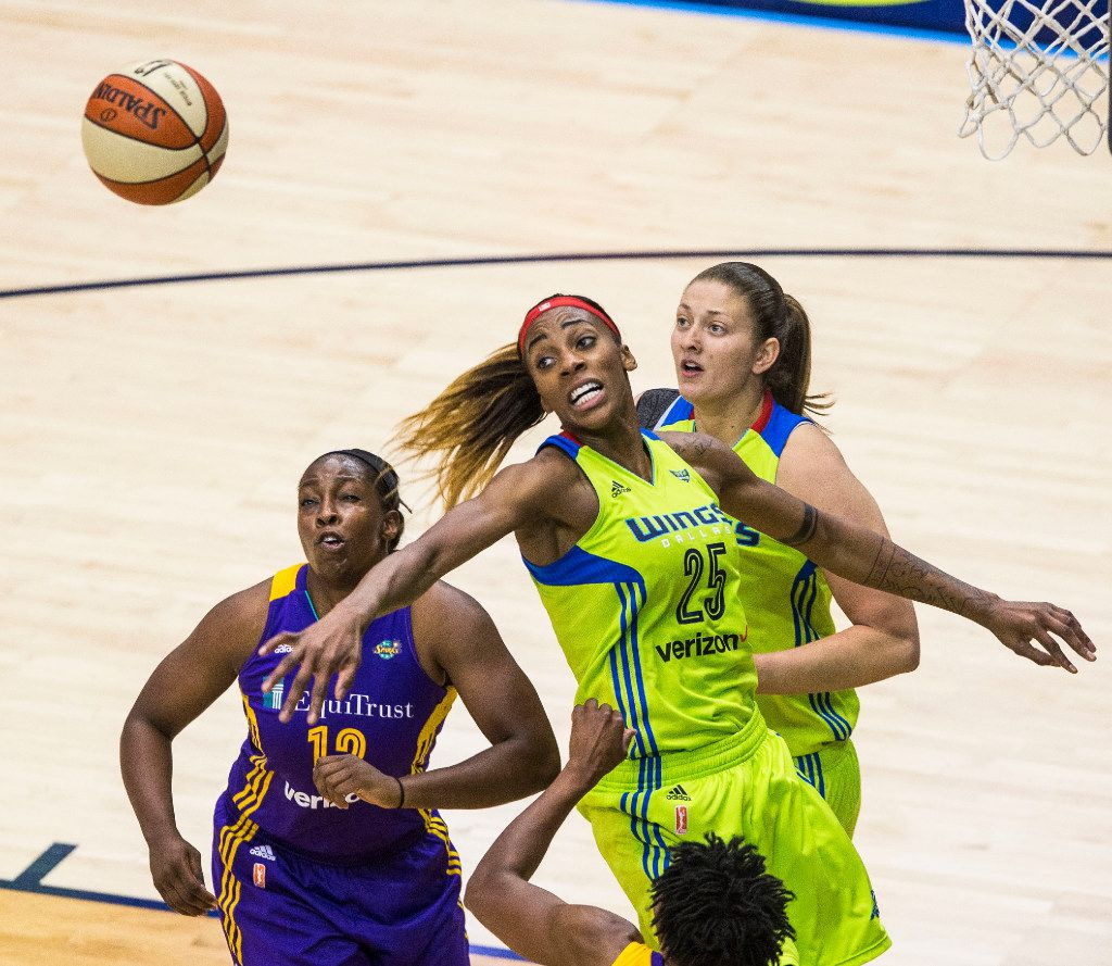 Dallas Wings forward Glory Johnson (25, middle) and forward Theresa Plaisance (right) and Los Angeles Sparks guard Chelsea Gray (12) reach for a rebound during a WNBA match-up between the Dallas Wings and the Los Angeles Sparks on Sunday, August 6, 2017, at College Park Center, in Arlington, Texas. (Ryan Michalesko/The Dallas Morning News)