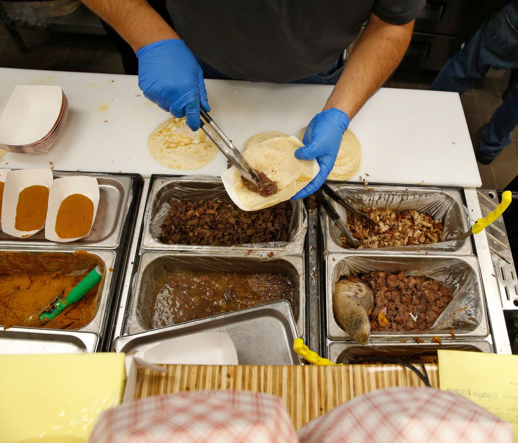 Chefs prepare tacos at Salsa Limon in Dallas on March 16, 2017.   (Nathan Hunsinger/The Dallas Morning News)
