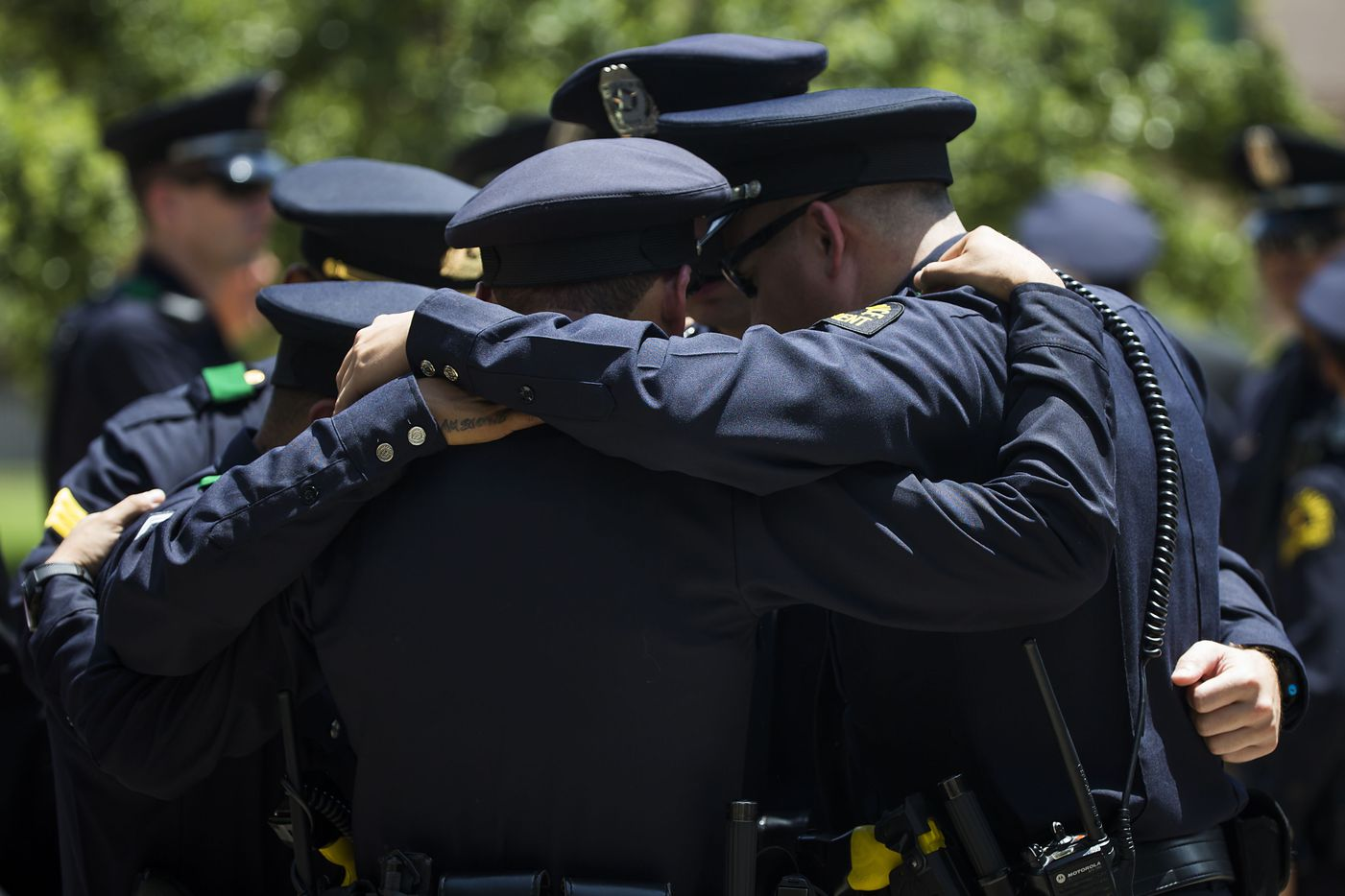 Dallas police officers huddle in prayer following funeral services for Dallas police Sr. Cpl. Lorne Ahrens at Prestonwood Baptist Churchon Wednesday, July 13, 2016, in Plano.