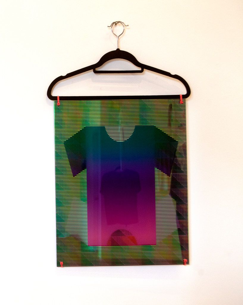 Brooklyn artist Kate Kosek, Kewl Lewk, 2019, UV pigment on plexiglass, zip ties and clothes hangers. Photographed at The Big Summer T-Shirt Show at Ex Ovo gallery in Dallas on July 14, 2019.