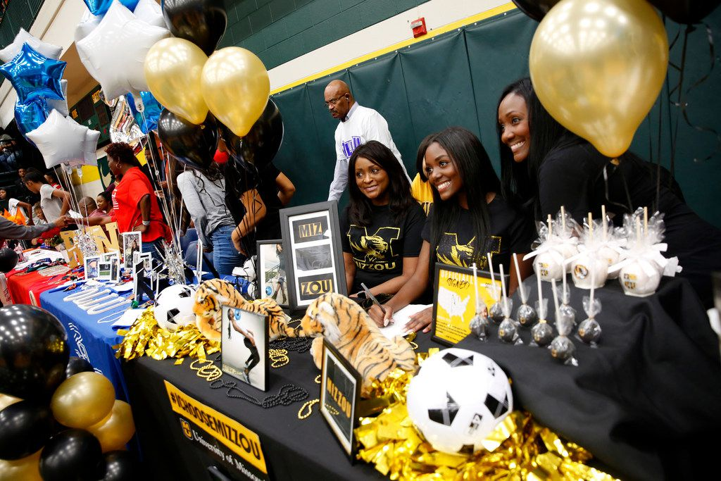 Soccer player Janna Singleton poses for a photograph with her family after signing with University of Missouri on National Signing Day at DeSoto High School on Wednesday, Feb. 6, 2019. (Rose Baca/Staff Photographer)