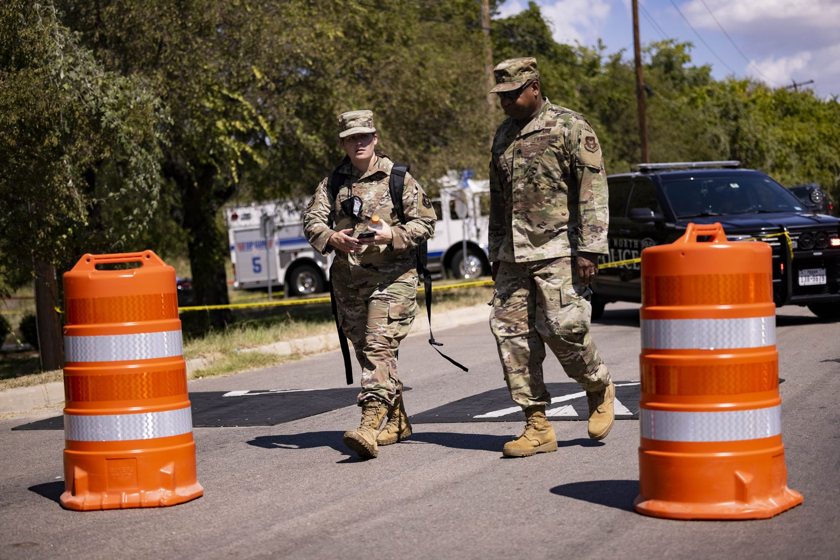 Members of the US Air Force leave the site where a military training aircraft crashed in a residential area on Sunday, Sept. 19, 2021, in Lake Worth. Two pilots were injured and three homes were damaged, officials said.