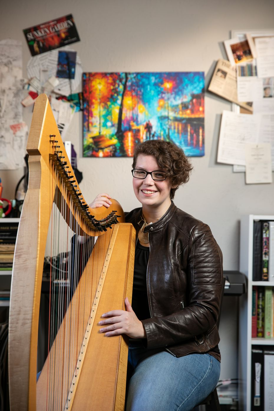 Kimberly Osberg played the harp last year in her Dallas apartment. She moved to Portland, Ore., in January but still works remotely for the Dallas Chamber Symphony.