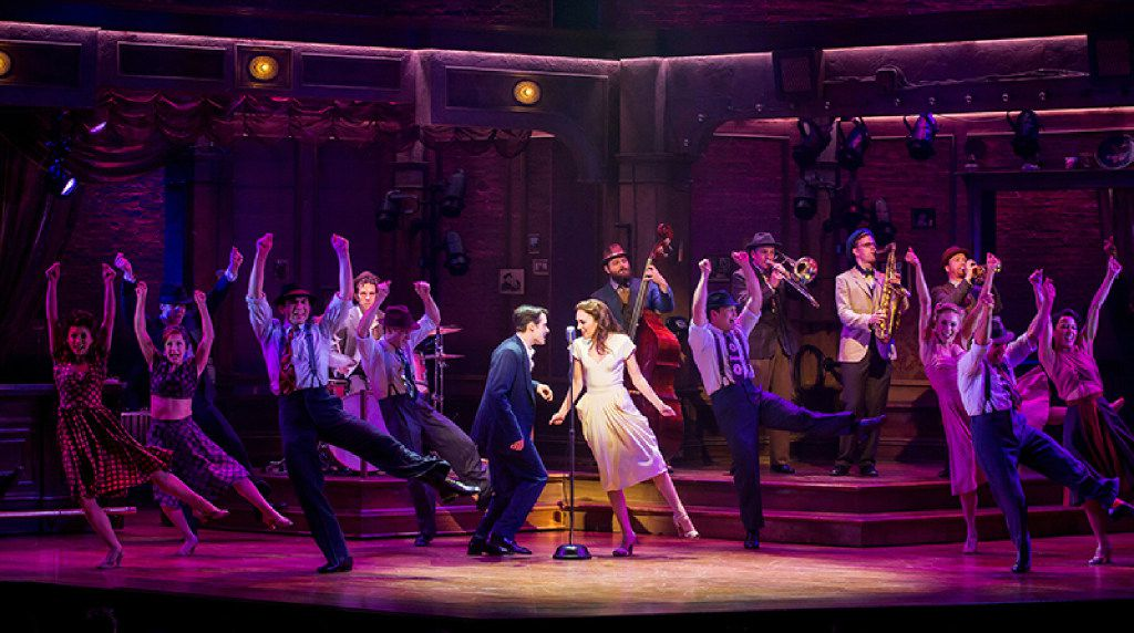 "Corey Cott, Laura Osnes (center) and the company of ""Bandstand"" on Broadway in April 2017"