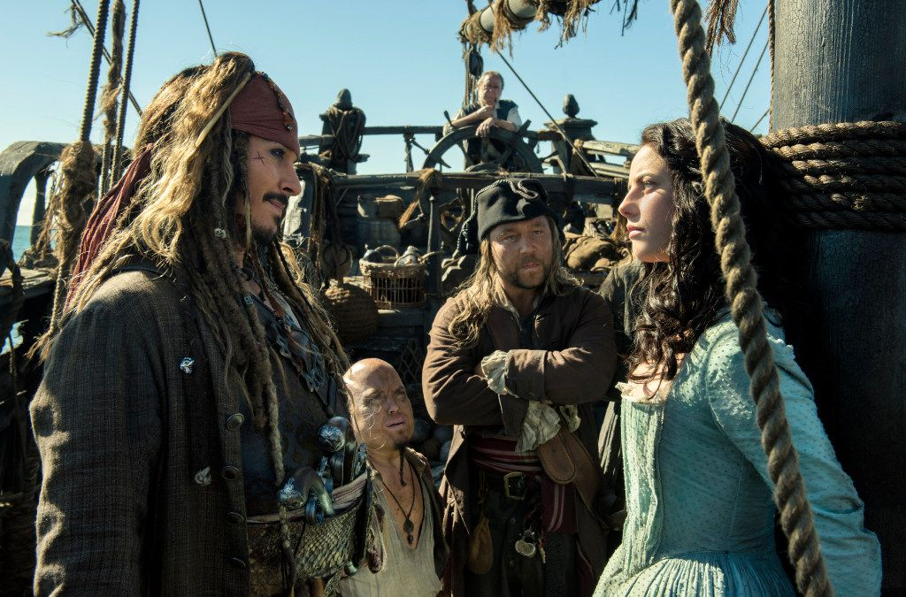 "In this image released by Disney, Johnny Depp portrays Jack Sparrow, left, and Kaya Scodelario portrays Carina Smyth, right, in a scene from ""Pirates of the Caribbean: Dead Men Tell No Tales."""