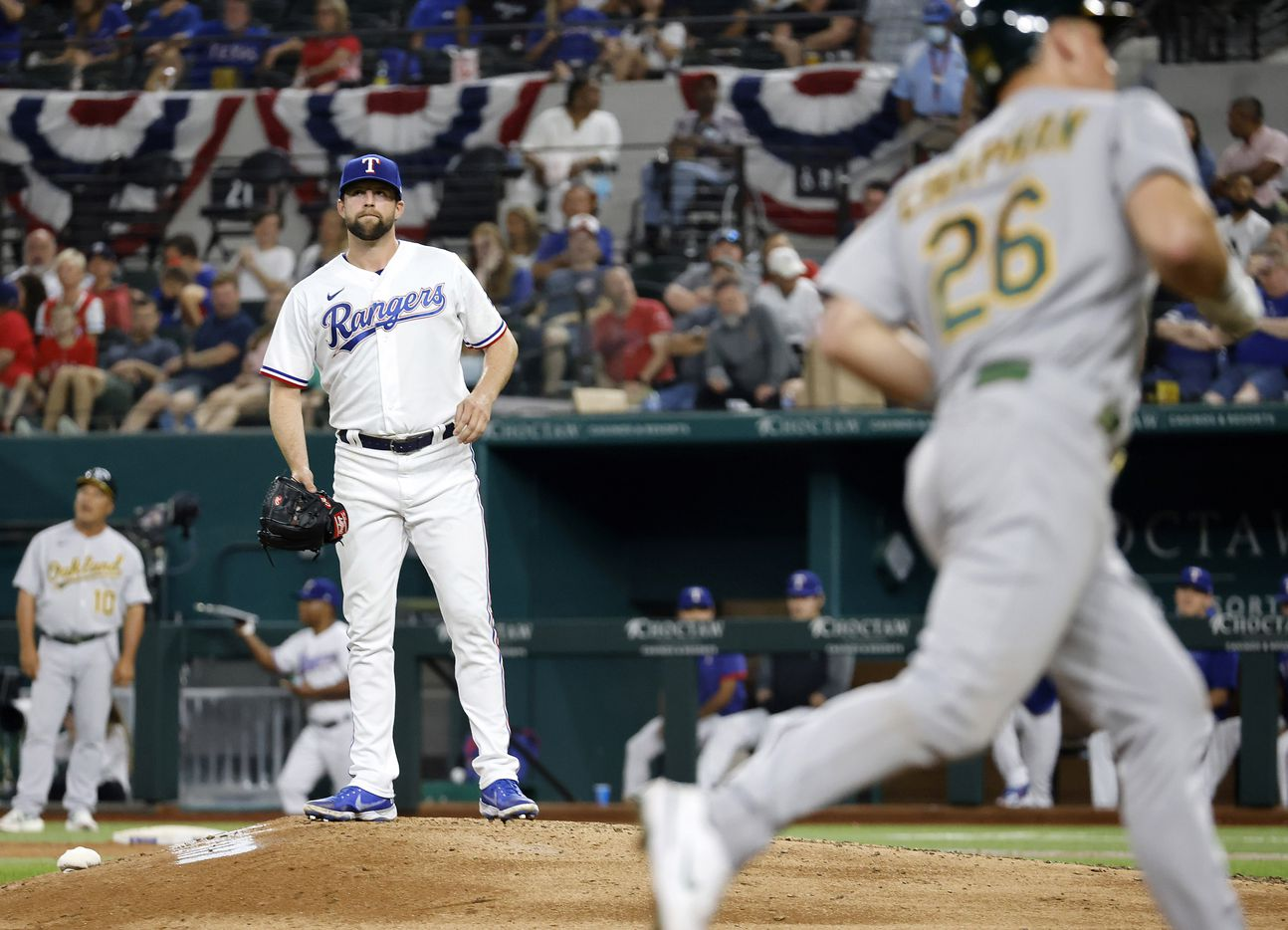 Texas Rangers starting pitcher Jordan Lyles (24) reacts after Oakland Athletics batter Matt Chapman (26) hit a seventh inning solo home run at Globe Life Field in Arlington, Saturday, August 14, 2021. Lyles was pulled from the game after back-to-back homers. (Tom Fox/The Dallas Morning News)