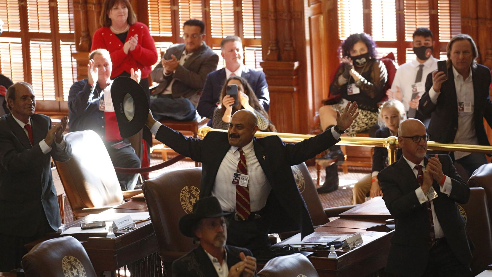 Maj. Marco A. Rodriguez (CD 23) and other Texas electors celebrate after the announcement of all 38 Texas electoral votes for President Donald Trump during the meeting of the presidential electors in the House Chamber of the Texas State Capitol on Monday, December 14, 2020 in Austin. All 38 electors voted for Trump and Vice President Mike Pence. (Vernon Bryant/The Dallas Morning News)