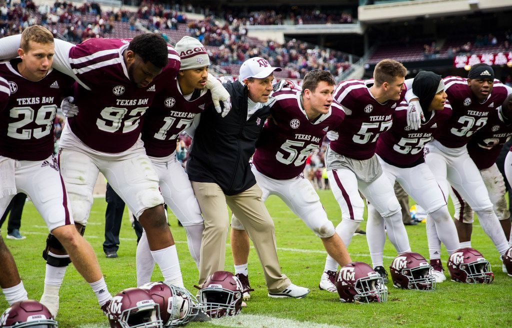 Texas A&M Aggies head coach Jimbo Fisher and players celebrate a 38-24 win over the Ole Miss Landsharks on Saturday, November 9, 2018 at Kyle Field in College Station, Texas. (Ashley Landis/The Dallas Morning News)