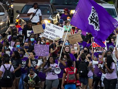 """Demonstrators marched on Elm Street in Dealey Plaza during the Not My Son organization's """"100 Women March"""" from Dallas City Hall to the Frank Crowley Courts Building on July 31."""