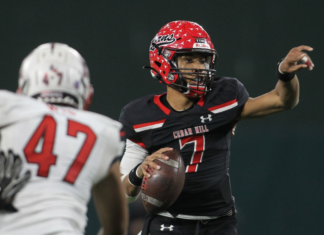 Cedar Hill quarterback Kaidon Salter (7) redirects the route for receiver Javien Clemmer (13) before connecting with him for the Longhorns' 27-24 overtime victory over Rockwall Heath to advance. Also pictured is Rockwall Heath defensive end Issac Gutierrez (47) as he applies pressure on the play. The two teams played their Class 6A Division l Region ll final football playoff game at Globe Life Park in Arlington on January 2, 2021. (Steve Hamm/ Special Contributor)