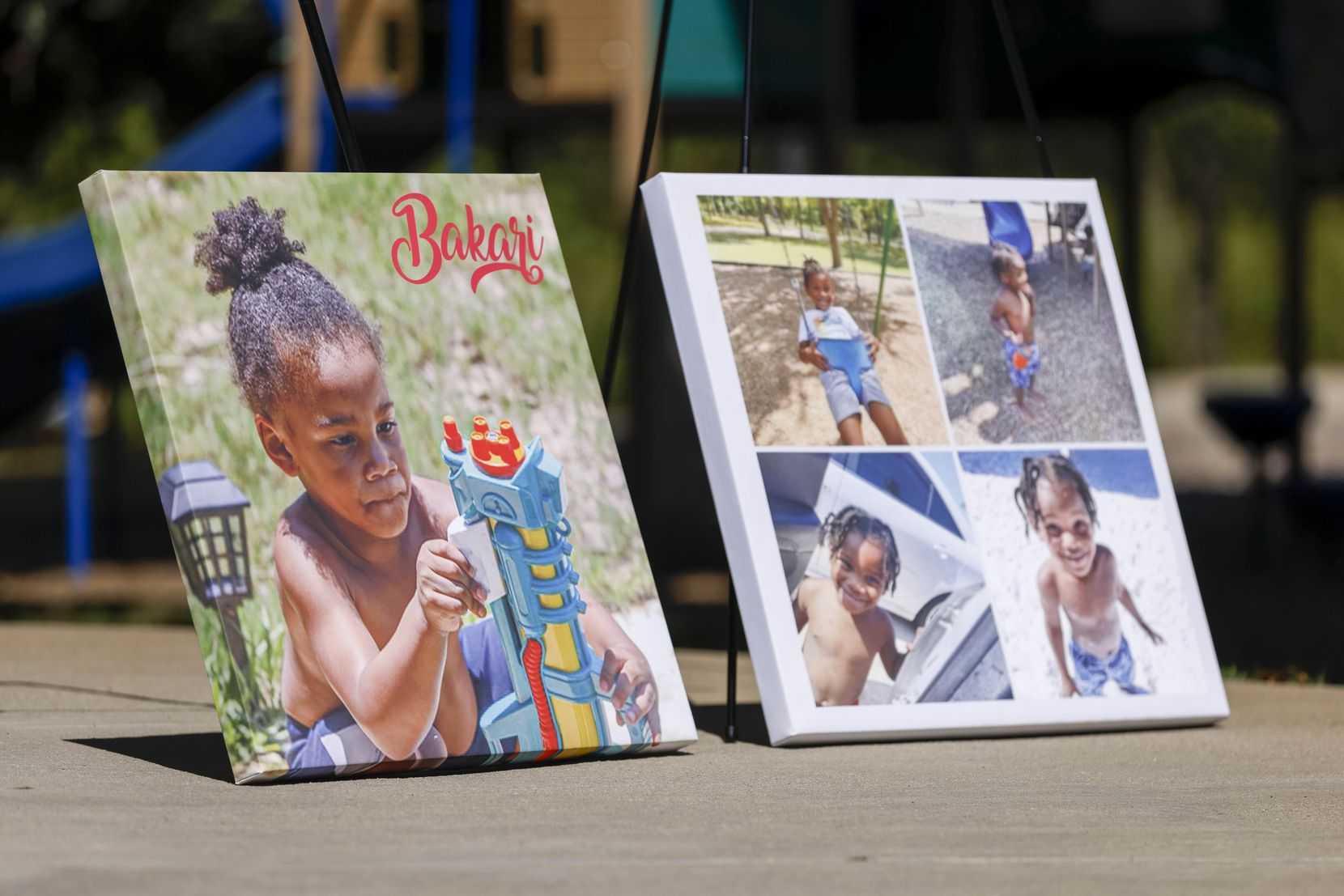Photos of 3-year-old Bakari Williams sit near the splash pad at Don Misenhimer Park during a press conference Monday in Arlington. Williams died after contracting an amoeba from an Arlington splash pad.