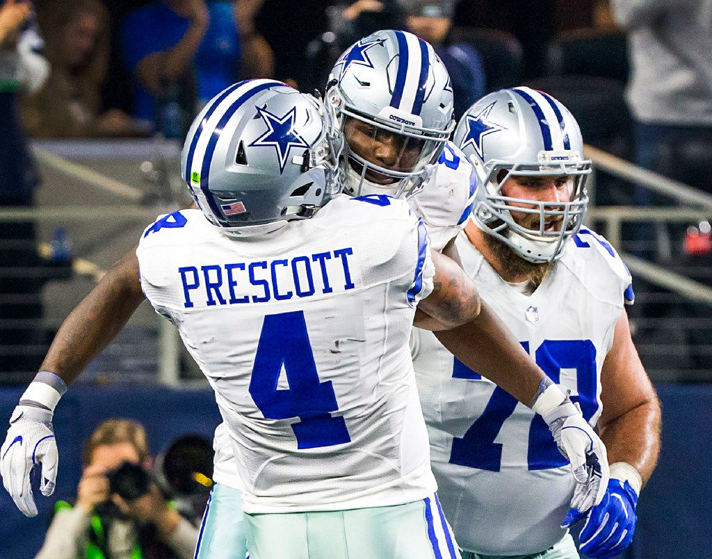 Dallas Cowboys quarterback Dak Prescott (4) celebrates after throwing a touchdown pass to wide receiver Dez Bryant (facing) during the first half of an NFL football game against the Detroit Lions at AT&T Stadium on Monday, Dec. 26, 2016, in Arlington, Texas. (Smiley N. Pool/The Dallas Morning News)