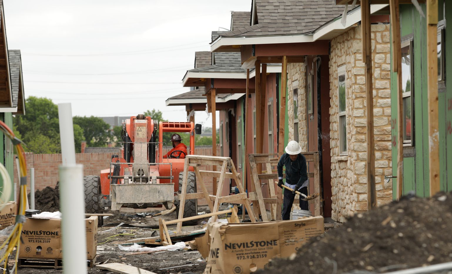 Workers build the homes at the Avilla Northside home community in McKinney.
