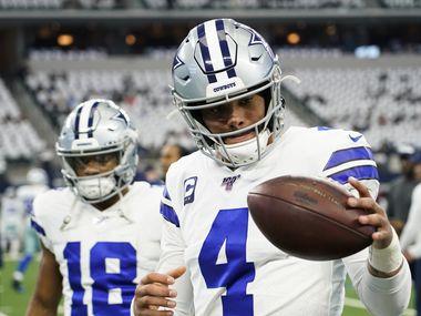Dallas Cowboys quarterback Dak Prescott warms up before an NFL football game against the Washington Redskins at AT&T Stadium on Sunday, Dec. 29, 2019, in Arlington.