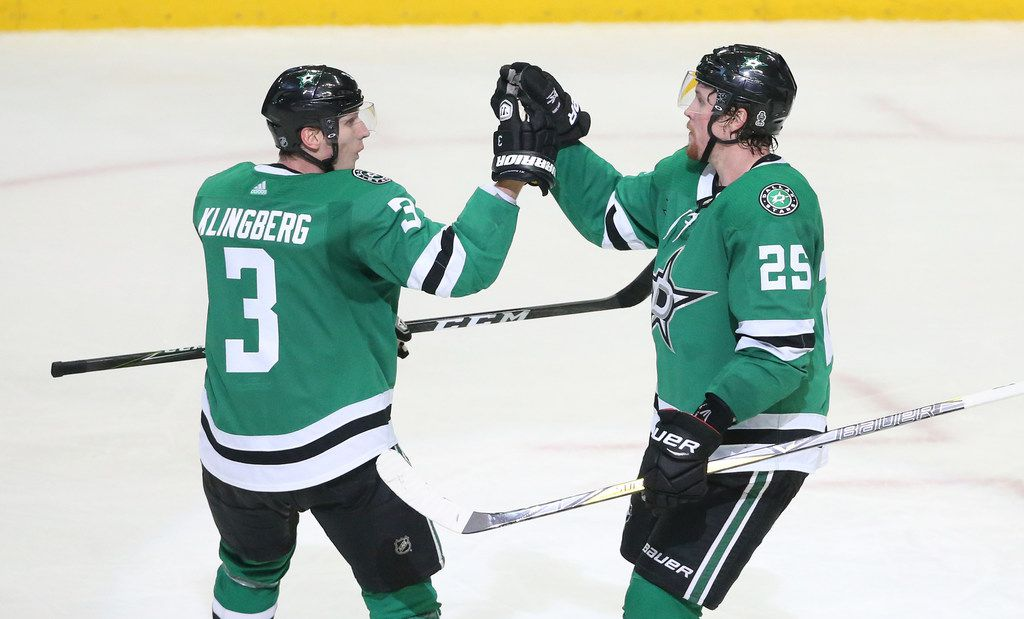 Dallas Stars defenseman John Klingberg (3) and right wing Brett Ritchie (25) celebrate a score during the New Jersey Devils vs. the Dallas Stars NHL hockey game at the American Airlines Center in Dallas on Thursday, January 4, 2018. (Louis DeLuca/The Dallas Morning News)