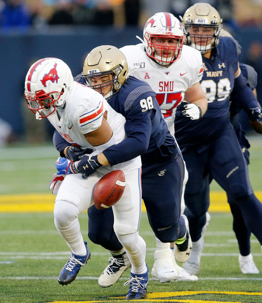 Navy Midshipmen defensive lineman Mike Flowers (98) forces Southern Methodist Mustangs running back Xavier Jones (5) to fumble the ball near the 20 yard line in the first quarter at Navy-Marine Corps Memorial Stadium in Annapolis, Maryland, Saturday, November 23, 2019. Navy recovered. (Tom Fox/The Dallas Morning News)