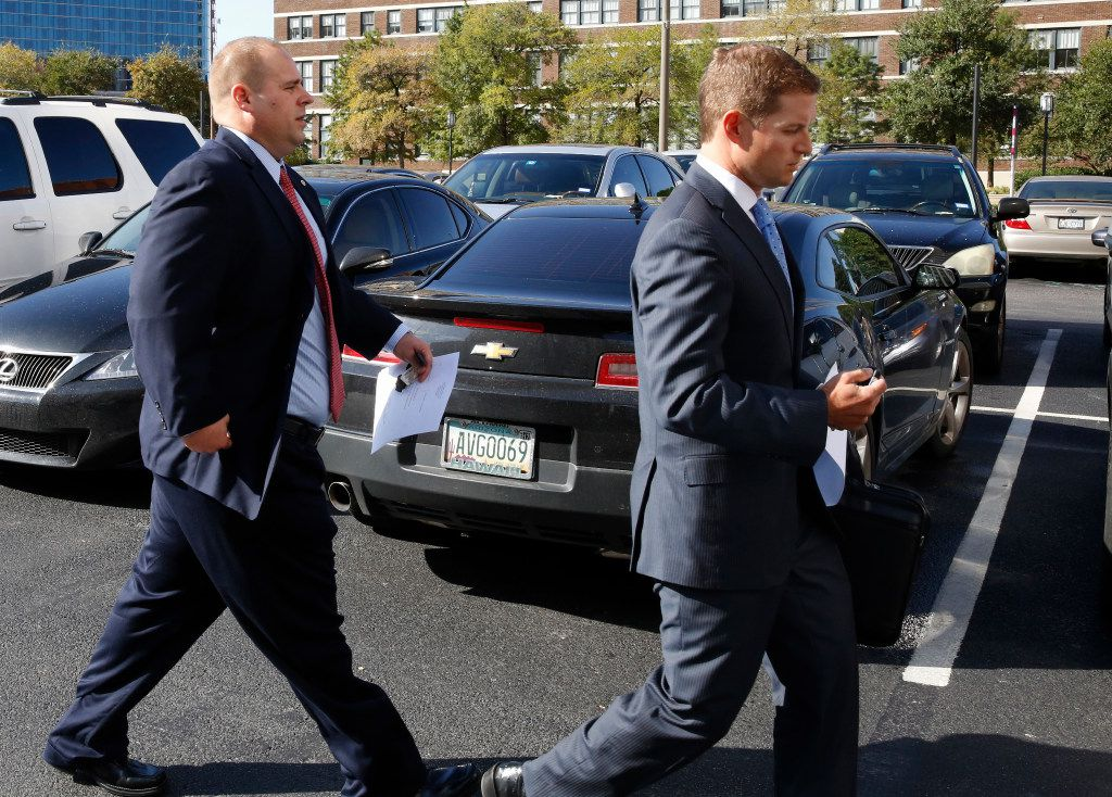 Blackstone walks to his vehicle with his lawyer after pleading guilty in federal court in Dallas.